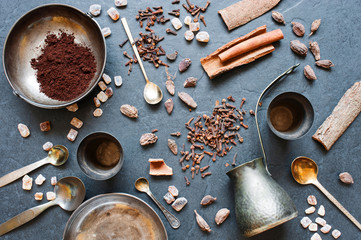 Coffee, spices and metal plates on a dark background