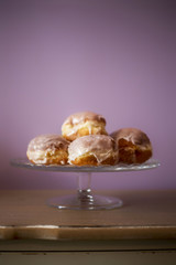 donuts lying on a decorative plate