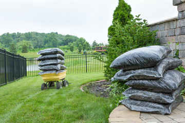 Bagged Mulches on Table and Wagon at the Backyard