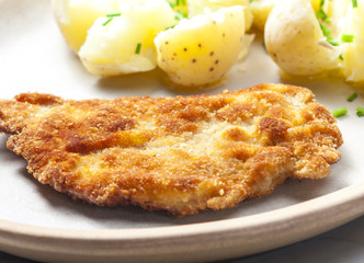 fried pork fillet with boiled unpeeled potatoes
