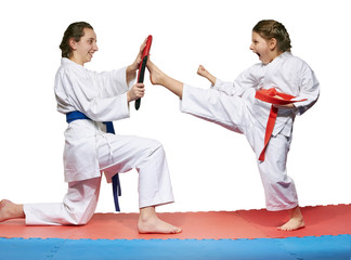Two sisters are trained develop kicking skills