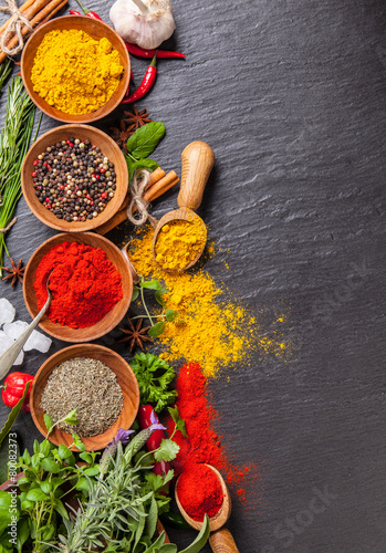 Various spices on black stone - 80082373