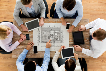 business team or architects with blueprint