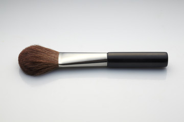 make up brush on gradient background