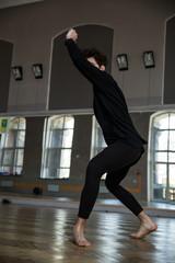 Young man dancing at gym