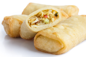 Fried chinese vegetable spring rolls on white surface.