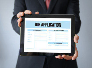 businessman with job application  on a tablet