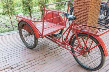 red trishaw for transportation in parking