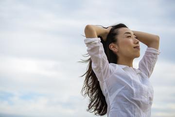 A woman on a beach in Kobe.