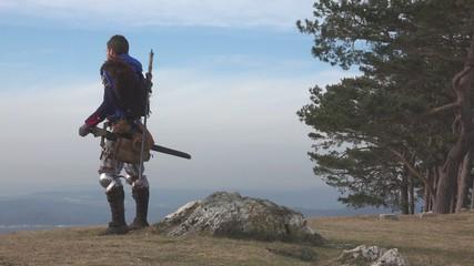 Assasin turning around on mountain