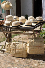 Street stall with typical straw hats and bags , Trinidad