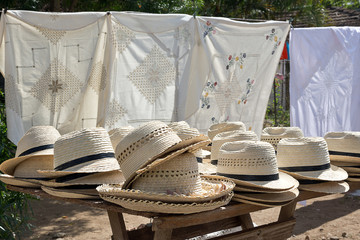 Straw hats on street stall in Trinidad