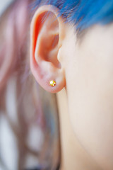 Woman's ear wearing a beautiful earring