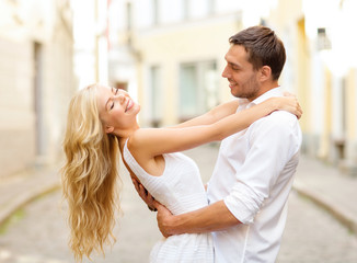smiling couple dancing in the city