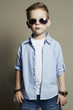Funny child.fashionable little boy in sunglasses.jeans