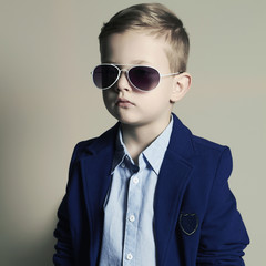 funny child.little boy in sunglasses.stylish kid in suit