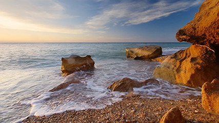 Big wave splashing on the stone