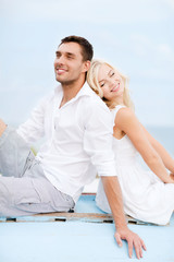 couple in shades at sea side
