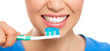 Healthy teeth and breath concept. Happy woman cleaning her teeth