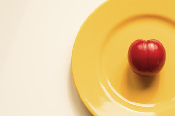 Victoria plum on a yellow plate