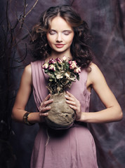 beautiful girl with dry roses