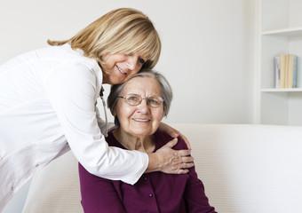 Senior women with home caregiver
