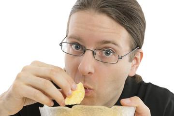 Close up of man eating junk food