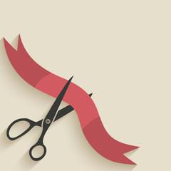 Scissors cut red ribbon
