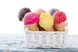 Fototapeta Ice cream scoops on wooden table.