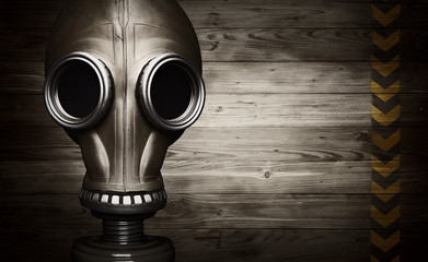 Gas mask on wooden background