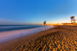 The beach of Barcelona in Spain at sunset