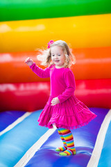 Happy little girl jumping and bouncing