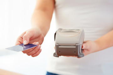 Woman accepts credit card to pay