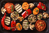 Fototapety Background of grilled vegetables close up. Horizontal top view