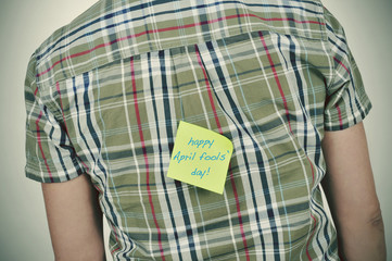 man with a sticky note with the text happy april fools day