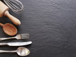 Cooking utensils on a dark grey background. - 80100106