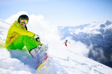 Snowboarder sitting