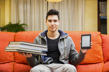 Man showing difference between ebook reader and books