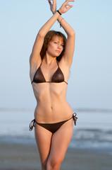Woman in bikini doing ballet move