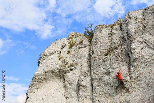 Rock climber on limestone rock near Krakow, Poland - 80102192