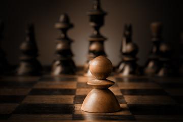 Chess. White pawn against all black.