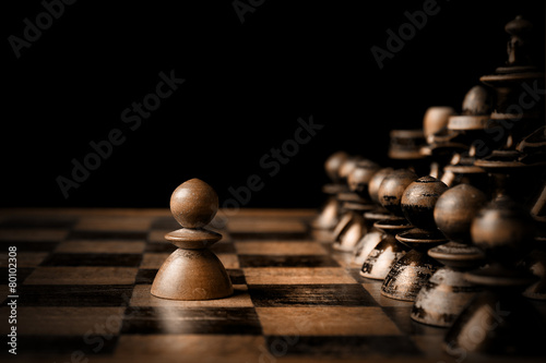 canvas print picture Chess. White pawn against all black.
