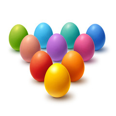 Decorated Easter eggs aligned in triangle and isolated on white