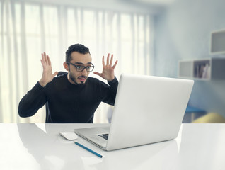 Man Shocked Reading Message on Computer in Office ..