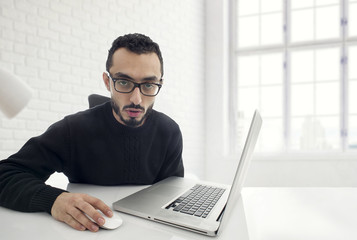 Man Shocked while working on computer in office