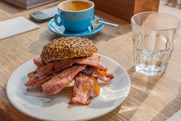 Bacon sandwich and coffee for a lunch break