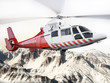 Leinwanddruck Bild - Rescue helicopter in flight over snow capped mountains