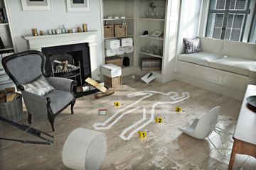 Home invasion , crime scene in a wrecked furnished home.