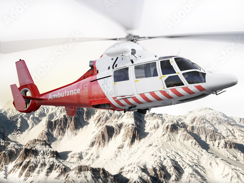 Leinwanddruck Bild Rescue helicopter in flight over snow capped mountains