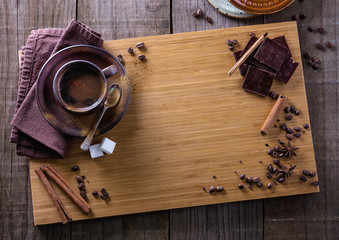 Top view of spiced coffee and spices with copyspace